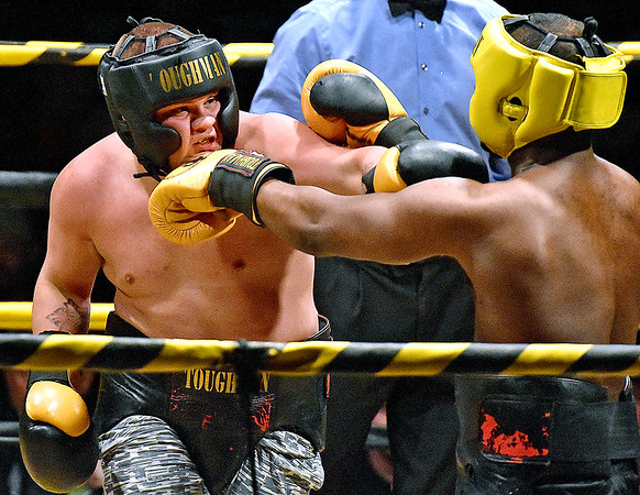 (Brad Davis/The Register-Herald) Nathaniel McGilton, left, takes on Kyle Bush during Saturday's Original Toughman Contest action at the Beckley-Raleigh County Convention Center.