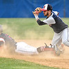 Independence's Ryan Brandstetter, left, looks up at the umpire's safe call through a cloud of dust as Bluefield shortstop Devon Goins is late with the tag during the second inning of the Patriots' game against the Beavers Wednesday evening in Coal City. Brandstetter legged out a double on the play after his high blooper to shallow right fell just out of reach of Bluefield second baseman Dominick Buzzo.