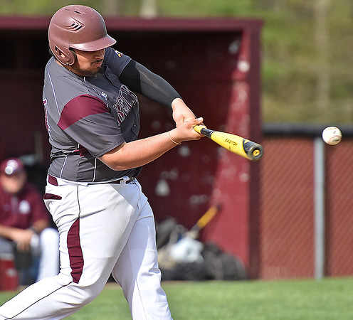 (Brad Davis/The Register-Herald) Woodrow Wilson's Bradley Pack drives in a run with a base hit during the Flying Eagles' loss to George Washington Friday afternoon in Beckley.