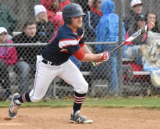(Brad Davis/The Register-Herald) Independence's Chase Mills connects for a bases-loaded double that cleared the bases and scored three runs during the Patriots' game against Bluefield Wednesday evening in Coal City.