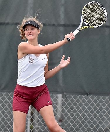 (Brad Davis/The Register-Herald) Woodrow Wilson's Sophie Hogg plays in a doubles match against Bluefield Wednesday afternoon in Beckley.