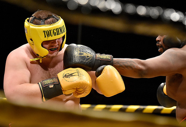 (Brad Davis/The Register-Herald) Noah McGraw, left, takes on Gary Edwards in a heavyweight matchup during Toughman Contest action Friday night at the Beckley-Raleigh County Convention Center.
