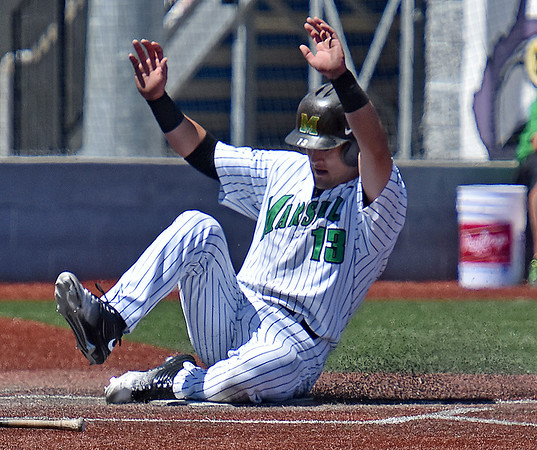 (Brad Davis/The Register-Herald) Marshall's Leo Valenti slides into home plate to score a run against Florida Atlantic Sunday afternoon at Linda K. Epling Stadium.
