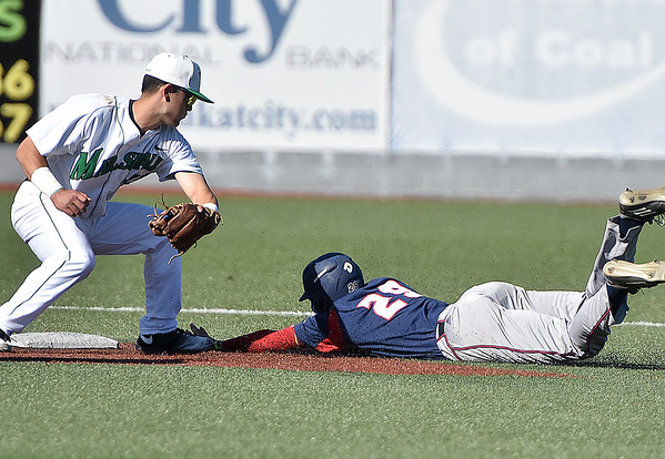 (Brad Davis/The Register-Herald) Florida Atlantic's Billy Endris dives safely into second after getting picked off at first and caught in a rundown before eventually being tagged out on a baserunning mistake between second and third Saturday afternoon at Linda K. Epling Stadium.