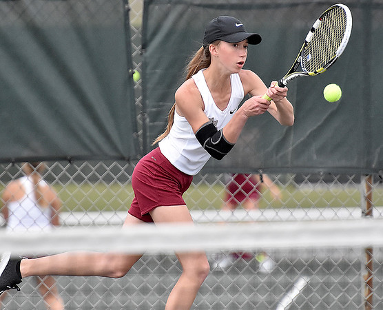 (Brad Davis/The Register-Herald) Woodrow Wilson's Bre Cecil plays in a doubles match against Bluefield Wednesday afternoon in Beckley.