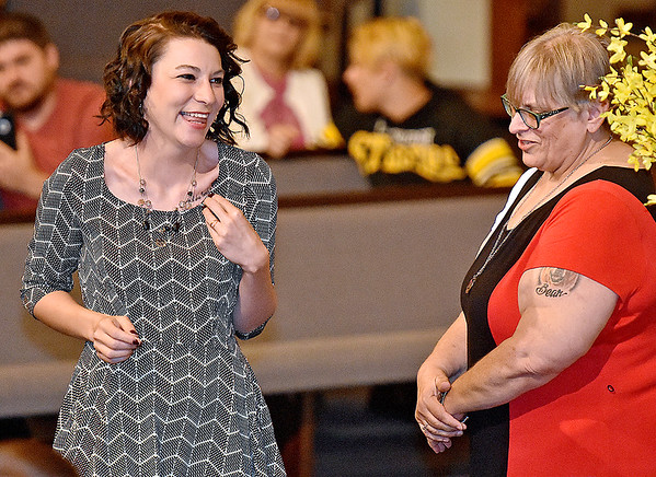 (Brad Davis/The Register-Herald) University of Charleston-Beckley graduate Natosha Wilson is all smiles after receiving her graduation pin from OTA Program Director Kay Blose, right, during a ceremony Friday night at Calvary Assembly of God. UC-Beckley's School of Health Sciences sent off its 2016 graduates from their Occupational Therapy Assistant and Radiologic Technology programs with a special pinning ceremony at the Sunset Drive church.