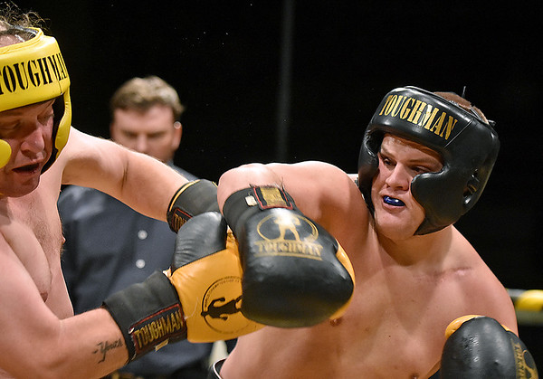 (Brad Davis/The Register-Herald) Nathaniel McGilton, right, takes on Jack Reverendo in a heavyweight matchup during Toughman Contest action Friday night at the Beckley-Raleigh County Convention Center.