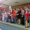 Folks gather to cut the ribbon at Giovanni's at Lester Square in Sophia.