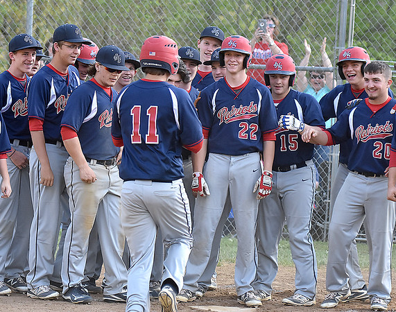 (Brad Davis/The Register-Herald) Teammates wait to greet Independence's Cody Green (#11) at home plate after blasting a third inning grand slam against Summers County Wednesday evening in Hinton.