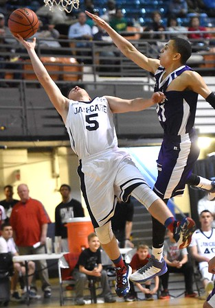Dahrius Nelson, of Cross Lanes Christian, right, playing for C. Adam Toney Class A all-stars, tries to block Larry Cook Jr., of Westside, playing for Jan-Care AA all-stars, shot during the Little General Scott Brown Classic held at the Beckley-Raleigh County Convention Center Saturday evening.<br /> (Rick Barbero/The Register-Herald)