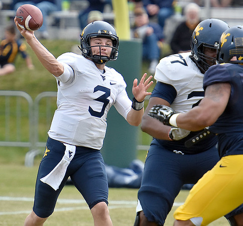 (Brad Davis/The Register-Herald) West Virginia quarterback Skyler Howard throws a pass during the Mountaineers' Gold-Blue Spring football game Saturday afternoon at The Greenbrier.