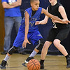 (Brad Davis/The Register-Herald) Shady Elite's Keynan Cook drives along the perimeter as WV Warriors' (Charleston) Luke Thompson defends during the 7th grade Spring Fling Tournament championship game Sunday afternoon at Shady Spring High School. WV Warriors went on to win the game.