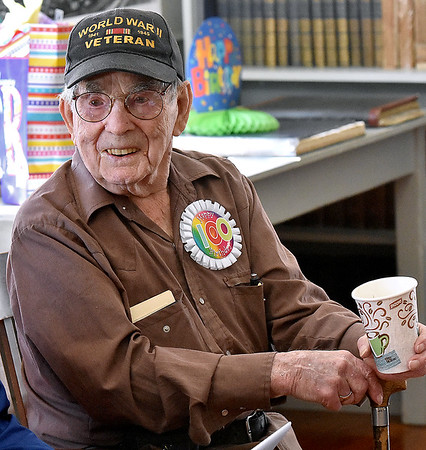 (Brad Davis/The Register-Herald) World War II veteran and former teacher Buford Hartsog shares a few laughs with friends and family as he celebrates his 100th birthday inside the school house on the Youth Museum/Exhibition Coal Mine grounds Saturday afternoon.