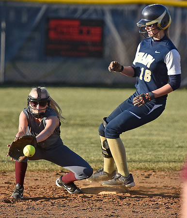 (Brad Davis/The Register-Herald) Shady Spring's Peyton Wiseman makes it easily into second base on a steal as Woodrow Wilson shortstop Katelynn Bolen catches the throw during the Tigers' game against the Flying Eagles Wednesday evening.
