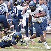 (Brad Davis/The Register-Herald) West Virginia quarterback WIlliam Crest Jr. breaks a tackle attempt by linebacker Shea Campbell during the Mountaineers' Gold-Blue Spring football game Saturday afternoon at The Greenbrier.