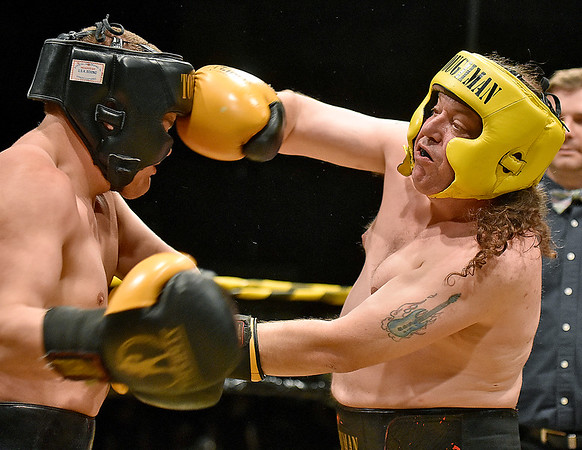 (Brad Davis/The Register-Herald) Jack Reverendo, right, takes on Nathaniel McGilton in a heavyweight matchup during Toughman Contest action Friday night at the Beckley-Raleigh County Convention Center.