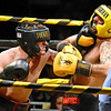 (Brad Davis/The Register-Herald) Dylan Newsome, left, lands a shot on Scott Miller during Saturday's Original Toughman Contest action at the Beckley-Raleigh County Convention Center.