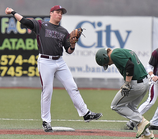 (Brad Davis/The Register-Herald) Fayetteville's Troy Farrell ducks out of the way as Woodrow Wilson shortstop Michael Maiolo turns a double play during the Flying Eagles' win over the Pirates Thursday afternoon at Linda K. Epling Stadium.