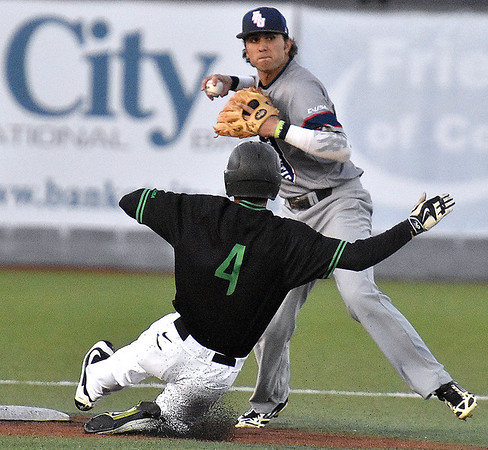 (Brad Davis/The Register-Herald) Marshall's Corey Bird is forced out at second base as Florida Atlantic shortstop C.J. Chatham turns a double play Friday night at Linda K. Epling Stadium.