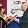 Debbie Sizemore, chairwoman of the Chamber of Commerce Board, presents Bill O'Brien with the Community Service Award during the Beckley-Raleigh County Chamber of Commerce 96th annual dinner held at the Beckley-Raleigh County Convention Center.<br /> (Rick Barbero/The Register-Herald)