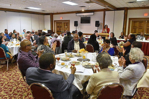 (Brad Davis/The Register-Herald) Attendees applaud while they eat as keynote speaker Dr. Carolyn Stuart addresses them during the Fayette County Black Caucus's annual Martin Luther King Memorial Luncheon Saturday afternoon at the Oak Hill Holiday Lodge.