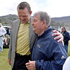(Brad Davis/The Register-Herald) Former West Virginia head coach Don Nehlen, right, and athletic director Shane Lyons talk following the Mountaineers' Gold-Blue Spring football game Saturday afternoon at The Greenbrier.