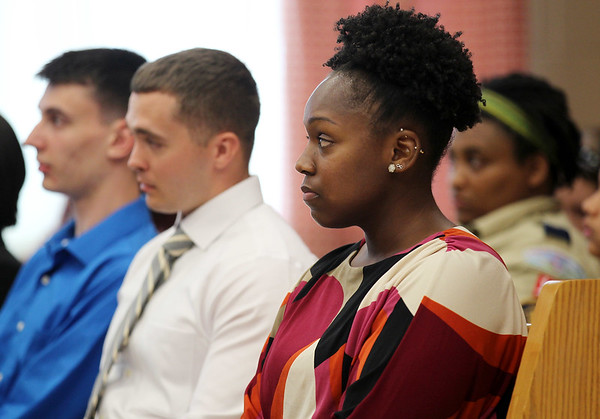 The Beckley Police Department ushered in five new recruits during the city council meeting on Tuesday, including Charlene Diggs, 24, right, who will be Beckley's first ever African-American female police officer. (Chris Jackson/The Register-Herald)