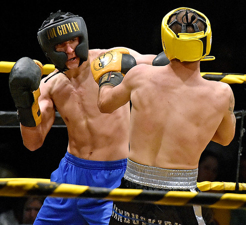 (Brad Davis/The Register-Herald) Michael Suttle, left, takes on Timothy VanBuskirk during Saturday's Original Toughman Contest action at the Beckley-Raleigh County Convention Center.