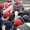 (Brad Davis/The Register-Herald) Greater Beckley Christian's Stephen Bjork, right, is mobbed by teammates at home plate after blasting a 3-run homer during the bottom of the 3rd inning of the Crusaders' win over Man Thursday evening.