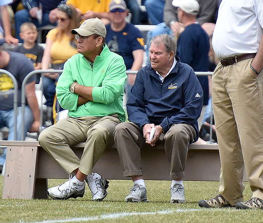(Brad Davis/The Register-Herald) Former West Virginia head coach Don Nehlen, right, and former Marshall head coach Bob Pruett take in the Mountaineers' Gold-Blue Spring football game Saturday afternoon at The Greenbrier.