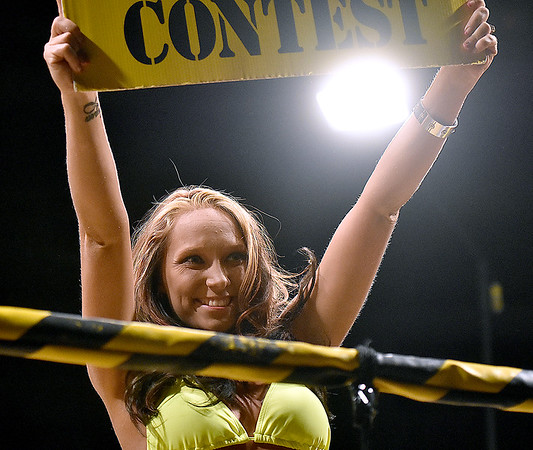 (Brad Davis/The Register-Herald) A ring girl does her thing during Toughman Contest action Friday night at the Beckley-Raleigh County Convention Center.