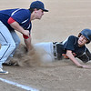 (Brad Davis/The Register-Herald) Summers County's Nathan Wykle, right, is tagged out at third by Independence third baseman Nick Lester after trying to advance on a pitch in the dirt that initially got away from catcher Ryan Brandstetter before he quickly recovered to throw Wykle out Wednesday evening in Hinton.