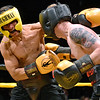 (Brad Davis/The Register-Herald) Ronaldo Dominguez, left, takes on Randy Ferrill in a lightweight matchup during Toughman Contest action Friday night at the Beckley-Raleigh County Convention Center.