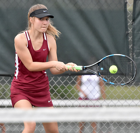 (Brad Davis/The Register-Herald) Bluefield's Lily Wright plays in a doubles match against Woodrow Wilson Wednesday afternoon in Beckley.