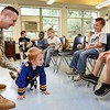 Wesley Bowling, Army National Guard Specialist, assists Bryson Acord, pre-k student, with doing pushups during the schools Career Day. Bowling demostated and spoke with the students about some of his traingng with the National Guard. Nine other vendors also participated and students rotated every 10 minutes to hear them speak about their careers.<br /> (Rick Barbero/The Register-Herald)