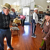 (Brad Davis/The Register-Herald) Buford Hartsog, right, and his younger brother Jarrell (left), 85, goof off during his 100th birthday celebration inside the school house on the Youth Museum/Exhibition Coal Mine grounds Saturday afternoon.