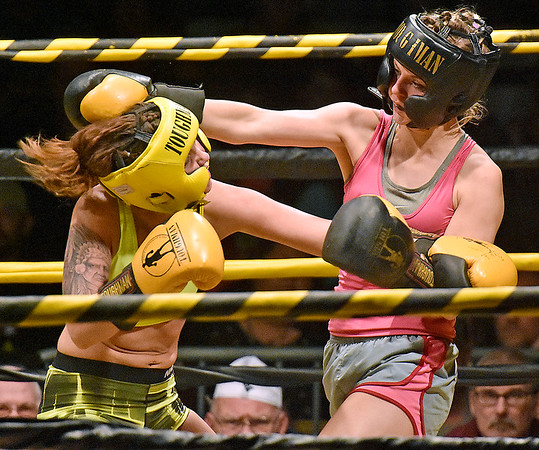 (Brad Davis/The Register-Herald) Mullens resident Hope McNeeley, right, takes on Wheeling's Adrienne Nelson during the women's super fight in Saturday's 37th annual Original Toughman Contest at the Beckley-Raleigh County Convention Center.