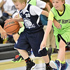 (Brad Davis/The Register-Herald) Southern West Virginia Wolfpack's Lucas Waddell tries to hold off Shady Elite's Carter Crook during a third grade division matchup in the Spring Fling Basketball Tournament Saturday afternoon at Daniels Elementary School.