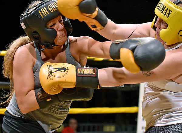 (Brad Davis/The Register-Herald) Amanda Shrewsbury, left, takes on Mickie Neihart during Toughman Contest action Friday night at the Beckley-Raleigh County Convention Center.