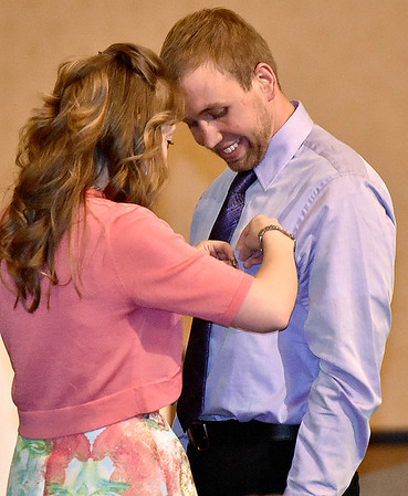 (Brad Davis/The Register-Herald) University of Charleston-Beckley graduate Christopher Short receives his graduation pin from Radiologic Technology Program Clinical Coordinator Penny-Jo Treadway, left, during a ceremony Friday night at Calvary Assembly of God. UC-Beckley's School of Health Sciences sent off its 2016 graduates from their Occupational Therapy Assistant and Radiologic Technology programs with a special pinning ceremony at the Sunset Drive church.