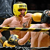 (Brad Davis/The Register-Herald) Robert Laughery, left, takes on Brandon Hendricks during Saturday's Original Toughman Contest action at the Beckley-Raleigh County Convention Center.