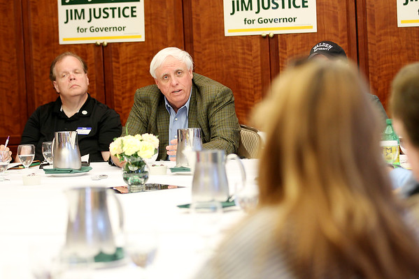 Jim Justice, who is running for governor of West Virginia, responds to a question poised from an educator during a meeting to discuss his views on education in the state at Tamarack Monday in Beckley. (Chris Jackson/The Register-Herald)