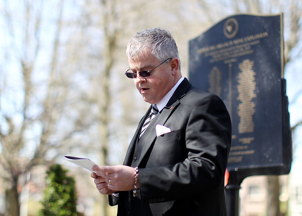 Delegate Mick Bates, (D-Raleigh), reads aloud the names of the 29 miners that were killed during the Upper Big Branch Mine explosion six years ago in front of a UBB placard during the annual memorial at the Raleigh County Courthouse in downtown Beckley on Tuesday. (Chris Jackson/The Register-Herald)