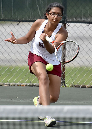 (Brad Davis/The Register-Herald) Woodrow Wilson's Nikki Zinzuwadia plays in a doubles match against Bluefield Wednesday afternoon in Beckley.
