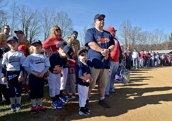(Brad Davis/The Register-Herald) Hundreds of young players and their coaches line the infield during Shady Spring Little League Opening Day festivities Saturday morning, many bearing the logos and uniforms of their favorite teams at major league level.