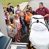 Jimmy Lilly, emt Best Ambulance, pulls the stretcher out of his ambulance and talked about his job to third grade students at Lester Elementary School during the schools Career Day. Total of ten vendors participated and students rotated every 10 minutes to hear them speak about their careers.<br /> (Rick Barbero/The Register-Herald)