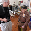 (Brad Davis/The Register-Herald) One of Hartsog's former students, Jeff Almond, shares a laugh with him during his 100th birthday celebration inside the school house on the Youth Museum/Exhibition Coal Mine grounds Saturday afternoon.