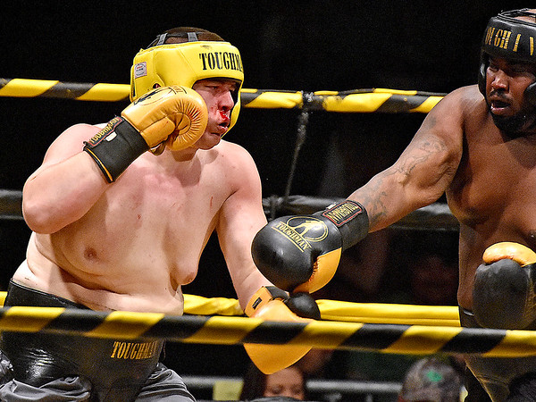 (Brad Davis/The Register-Herald) Gary Edwards, right, and Leland McClanahan square off during Saturday's Original Toughman Contest action at the Beckley-Raleigh County Convention Center.