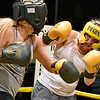 (Brad Davis/The Register-Herald) Mickie Neihart, right, takes on Amanda Shrewsbury during Toughman Contest action Friday night at the Beckley-Raleigh County Convention Center.