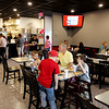 Giovanni's patrons enjoy free pizza at their grand opening in Lester Square in Sophia recently.